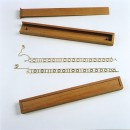 Binaire code; gouden armbanden, beukenhouten doosjes